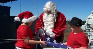Santa hoists flag 300x157 December Events Aboard the Battleship NORTH CAROLINA