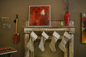 Sunset River Marketplace art gallery in Calabash is presenting a holiday show through Dec. 31. Shown, L-R: folk art signs by Ginny Lassiter; cigar box guitar by Karen Edgar; Star Birth, acrylic on canvas by Jill Hope; hand-blown glass pear by Scott Summerfield; red clay vase by Lantern Hill Pottery; Calabash II, acrylic on canvas by Ginny Lassiter; front: hand-sewn linen Christmas stockings by Mona Bendin.