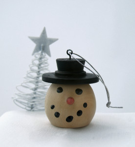"Turned wood snowman ornament is by James ""Red"" Saunders."