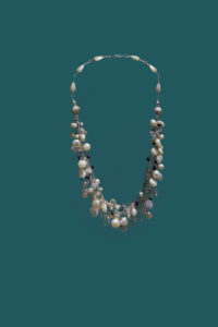 Deb Hill, Hand crocheted necklace with fresh water pearls, mother of pearl, glass beads and gem stones.